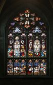 VIENNA, AUSTRIA - OCTOBER 11: Jesus' baptism and the Transfiguration on Mount Tabor, Stained glass in Votiv Kirche (The Votive Church). It is a neo-Gothic church in Vienna, Austria on October 11, 2014