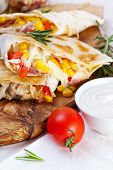 Mexican tortilla with meat stuffing, corn and vegetable salsa