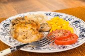 foto of southern fried chicken  - Southern Style fried chicken and mashed potatoes on cane place mat against rustic old fashioned wood background.  ** Note: Shallow depth of field - JPG