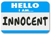 picture of innocence  - Hello I Am Innocent words written on a name tag or sticker badge to illustrate you are good and pure - JPG