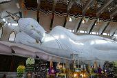 pic of recliner  - big white reclining buddha statue in buddhist church - JPG