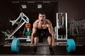 picture of lifted  - Muscular Men Lifting Deadlift In The Gym - JPG