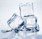 picture of ice-cubes  - Three melting ice cubes on glass table - JPG