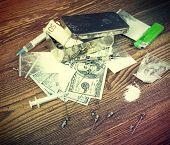 picture of drug dealer  - Vintage toned photo of drugs money needles and syringes on a wooden background - JPG