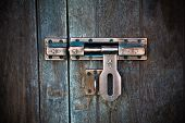 pic of hasp  - Image of ancient bolts installed on the old wooden door - JPG