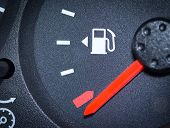 pic of fuel economy  - Car Fuel Gauge Showing Empty close up - JPG