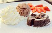 stock photo of ice-cake  - Chocolate Lava Cake with ice cream and strawberry - JPG