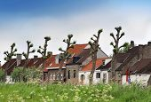 stock photo of damme  - This photograph represent a beautiful village with tiled roof - JPG