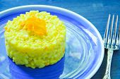 stock photo of saffron  - Risotto with pumpkin flowers with saffron cream - JPG