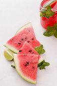 picture of watermelon slices  - Watermelon slices and watermelon fruit drink on table - JPG
