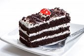 pic of black-cherry  - Slice of Black forest cake with cherry on top - JPG