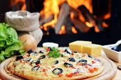 foto of hot fresh pizza  - fresh baked tasty pizza near wood oven - JPG