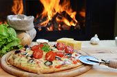 picture of hot fresh pizza  - fresh baked tasty pizza near wood oven - JPG
