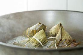 image of chinese wok  - Zongzi boiling in a wok - JPG