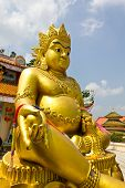 foto of emei  - Golden Buddha Statue in temple of Thailand - JPG