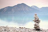 Постер, плакат: Balanced Stones On Mountain Lakeshore Children Built Pebbles Pyramid