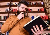Man On Busy Thoughtful Face Reading Book, Bookshelves On Background. Education And Science Concept.  poster