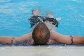 foto of good-looker  - Man is resting in the pool  - JPG