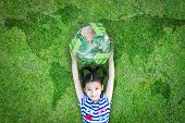 Sustainable World Environment And Csr With People Campaign Concept With Girl Kid Raising Earth On Gr poster