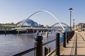 stock photo of tyne  - View of the Sage building and Tyne bridges from Newcastle quayside - JPG