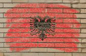 Flag Of Albania On Grunge Brick Wall Painted With Chalk