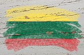 Flag Of Lithuania On Grunge Wooden Texture Painted With Chalk