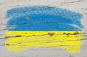 Flag Of Ukraine On Grunge Wooden Texture Painted With Chalk