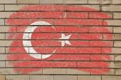 Flag Of Turkey On Grunge Brick Wall Painted With Chalk