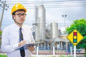 Male Engineer Checking In Factory With Note On Notepad Or  Industry Blurred Background.metaphor Qual poster