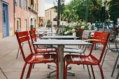 Theme Cafes And Restaurants. Exterior Summer Terrace Of Bright Colors Of Street Cafe Shop In Europe  poster