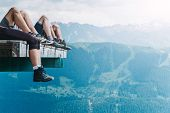 Relaxation Of Hikers In The Mountains After A Long Walk, Tourists Legs In Trekking Shoes Chilling On poster