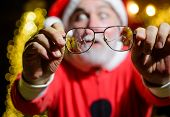 Eyeglasses With Broken Lens. Selective Focus. Santa Claus Holds Cracked Eyeglasses. Santa Man With B poster