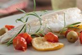 Baked sea bass with cherry tomato, olives, and rosemary