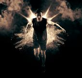 Athletic man sprinter running on smoke background. Exploding start poster