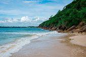 A Beautiful Sandy Tropical Beach With Stone Cliffs And A Jungle Above Them. Jungle Beach, Unawatuna, poster