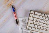 W-9 Usa Federal Business Finance Tax Form From The Internal Revenue Service With Pen, Computer Keybo poster