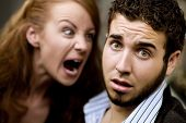 stock photo of woman couple  - Young woman yells at man with beard - JPG