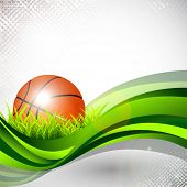 Shiny basketball in green grass on green wave and grungy grey abstract background. EPS 10.