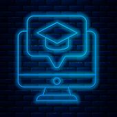 Glowing Neon Line Computer Monitor With Graduation Cap Icon Isolated On Brick Wall Background. Onlin poster