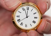Brass Small Watch Or Clock In Fingers