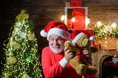 Christmas. Santa Claus Man With Teddy Bear On Shoulders. Bearded Man In Santa Claus Costume With Ted poster