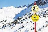 Signs In The Mountains At A Ski Resort With Hazard Warnings. poster