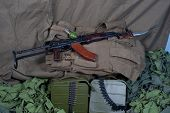 picture of akm  - Vintage background Concept with AK 47 rifle - JPG