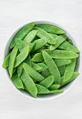 Snow peas in white bowl