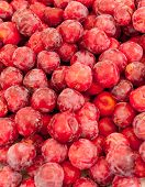 Red plums in the market, ideal for backgrounds