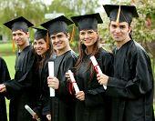 foto of graduation cap  - group graduation of students looking very happy - JPG