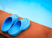 Blue Sandals On The Poolside