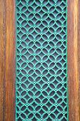 Green Painted Metal Grate On City Door