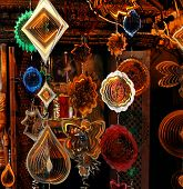 stock photo of bric-a-brac  - Shniy decor ornaments hanging from ceiling on market - JPG