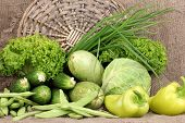 fresh green vegetables on sackcloth background